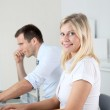 Man and woman working in the office on laptop computer — Stock Photo #18254389