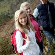 Parents and daughter walking in the countryside - Stockfoto