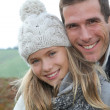 Happy father with daughter in fall season — Stock Photo