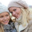 Closeup of mother and daughter in fall — Stock Photo