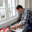 Plumber fixing domestic sink — Stock Photo #18255143