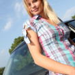 Young woman driving new car — Stock Photo