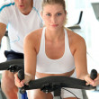 Stock Photo: Mand womdoing indoor biking