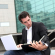 Stock Photo: Salesmworking outside building of offices
