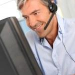 Customer service employee with headphones — Stock Photo #18258265