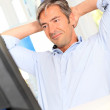 Man relaxing in office with stretched arms — Stock Photo #18258291