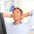 Man relaxing in office with stretched arms — Stock Photo #18258309
