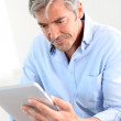 Office worker using electronic tablet — Stock Photo