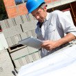Construction manager using electronic tablet on building site — Stock Photo