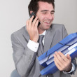 Salesman having bunch of work - Foto Stock