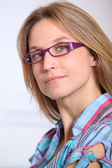 Closeup of beautiful blond woman wearing eyeglasses — Stock Photo