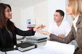 Property owners getting keys of their home — Stock Photo