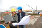Architect and engineer on construction site — Stock Photo