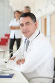 Closeup of doctor sitting in his office — Stockfoto
