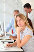 Beautiful woman working in the office on laptop computer — Stock Photo