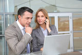 Sales working outside modern building — Stock Photo