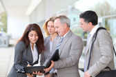 Business meeting at an exhibition — Stock Photo