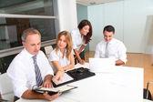 Business meeting around table — Stock Photo