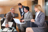 Group of associates meeting in lounge — Stock Photo