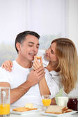 Couple having breakfast during the week end — Stock Photo