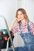 Woman using electric drill at home — Stock Photo