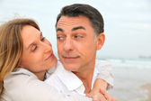 Couple embracing each other at the beach — Stock Photo