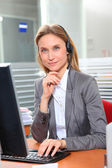 Blond office worker with headphones — Stock Photo