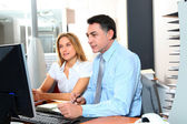 Manager and employee in front of computer in the office — Stock Photo