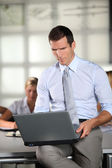 Businessman working in the office with laptop — Foto Stock