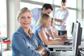 Closeup of blond woman attending training course — Stock Photo