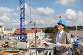 Businessman controlling site under construction — Stock Photo