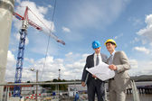 Businessman controlling site under construction — Stockfoto