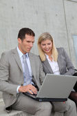 Sales meeting in front of building — Stock Photo