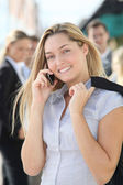Closeup of blond businesswoman standing outside — Stockfoto