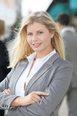 Blond businesswoman with arms crossed — Stock Photo