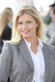 Smiling businesswoman standing outdoors — Stock Photo