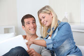 Closeup of couple sitting in sofa surfing on internet — Stock Photo