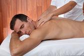 Man having a facial massage in spa center — Stock Photo