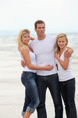 Couple and daughter standing by the sea — Stock Photo