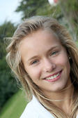 Closeup of smiling blond girl — Stock Photo