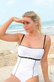 Closeup of beautiful blond woman in swimsuit — Stock Photo