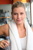 Woman drinking water after exercising — Stock Photo