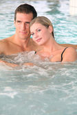 Couple bathing in jacuzzi of spa center — Stock Photo