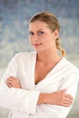 Beautiful woman with bathrobe standing by spa pool — Stock Photo
