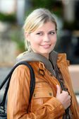Blond woman doing shopping in town — Stock Photo