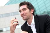 Man using cellphone in town — Stock Photo