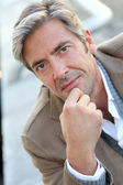 Portrait of handsome mature man in town — Stock Photo