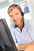 Customer service employee with headphones — Stock Photo