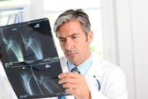 Man looking at Xray results — Stock Photo