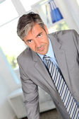 Businessman with persuasive look — Stock Photo